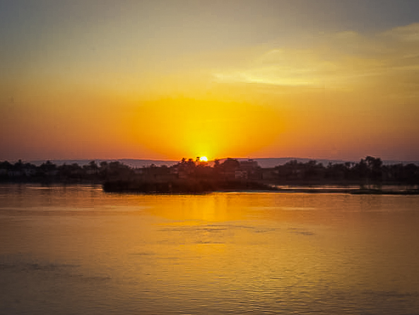 169.Sunset ove the Nile from our cabin window